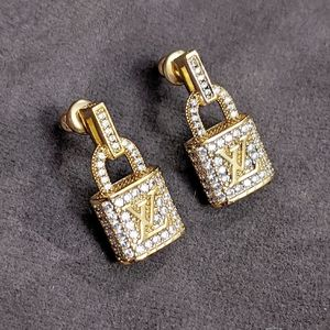 LV lock gold tone earrings